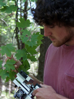 Photograph of a student taking photosynthesis measurements
