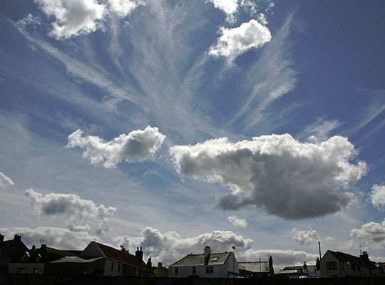 High, cold cirrus and lower, puffy cumulus clouds