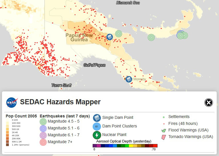 This image of Papua New Guinea shows population densities indicated by brown and yellow shaded areas, with darker colors indicating higher densities. Red dots indicate fires or other hotspots detected by NASA's MODIS instrument. Green and blue circles indicate earthquakes detected in the past seven days. Blue icons indicate dams. Image: NASA SEDAC, 09/24/15.