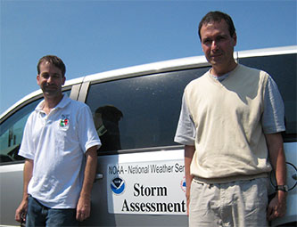Kevin Gallo (R) with co-investigator Philip Schumacher (NOAA/National Weather Service, L) at a 2011 storm survey.