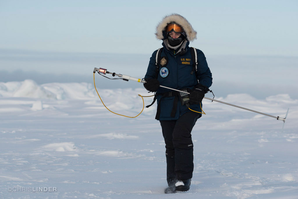 Gina Henderson on the north slope of Barrow, Alaska, in March 2013. She is holding a snow probe, which is used to measure snow depth and record the GPS location of each measurement. Image © Chris Linder.